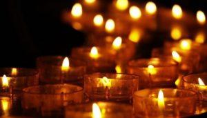 lit candles in dark